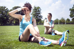 Two young girls stetching. Before a jogging royalty free stock images
