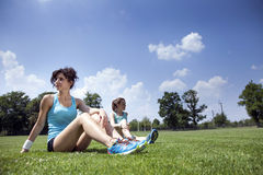 Two young girls stetching before a jogging Stock Image