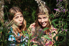 Two young girls in a summer forest Royalty Free Stock Photo