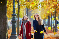 Two young girls on a sunny fall day Royalty Free Stock Image