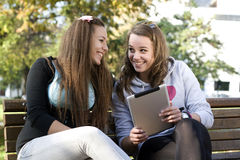 Two young girls with tablet pc Royalty Free Stock Image