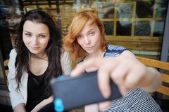 Two young girls taking a self portrait Stock Photography