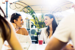 Two young girls talking during lunch break Stock Photos