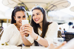 Two young girls talking during lunch break Stock Images