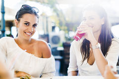 Two young girls talking during lunch break Stock Photo