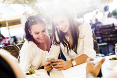 Two young girls talking during lunch break Royalty Free Stock Photo