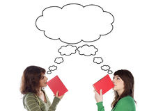 Two young girls thinking with books Stock Photos