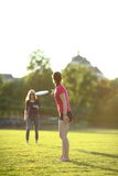 Two young girls are throwing a frisbee Royalty Free Stock Photos