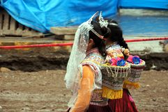 Two young girls in traditional clothing - Andes - Peru royalty free stock image