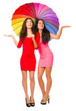 Two young girls with umbrella Royalty Free Stock Photos