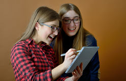 Two young girls using pc tablet Stock Photography