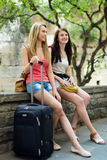 Two young girls on vacation with baggage Stock Photos