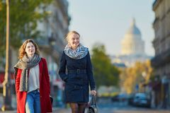 Two young girls walking together in Paris Stock Image