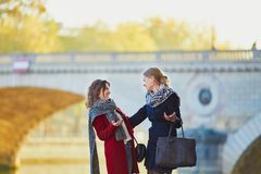 Two young girls walking together in Paris Royalty Free Stock Images