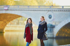 Two young girls walking together in Paris Stock Images