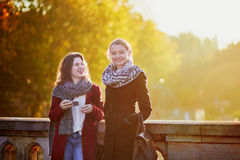 Two young girls walking together in Paris Royalty Free Stock Photo