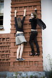 Two Young Girls On The Wall Royalty Free Stock Images