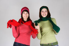 Two young girls in warm scarfs and hats Stock Photography