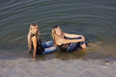 Two young  girls in water Stock Image
