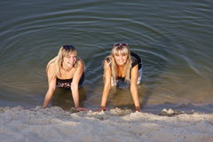 Two young  girls in water Royalty Free Stock Images