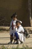 Two young girls wearing school uniform, Bardia, Nepal Royalty Free Stock Photo
