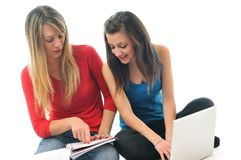 Two young girls work on laptop isolated Stock Image