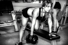 Two young girls workout in the gym Stock Image