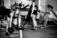 Two young girls workout in the gym Royalty Free Stock Photography