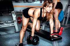 Two young girls workout in the gym Stock Photography