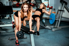 Two young girls workout in the gym Stock Photo