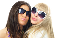 Two young glamorous girls sending us an air kiss Royalty Free Stock Photos