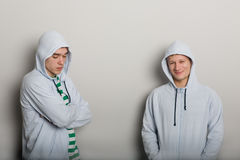 Two young guys. On the background of a gray wall royalty free stock photos