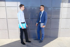 Two young guys businessman discussing important issues, make dec stock image