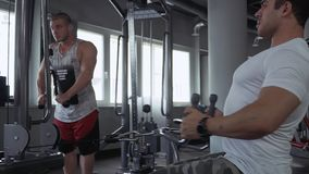 Two young guys in the gym stock video footage