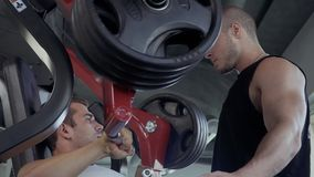 Two young guys in the gym stock footage