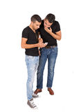 Two young guys look at cell phone Royalty Free Stock Photo