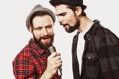 Two guys singing over white background. Two young guys singing over white background Stock Image
