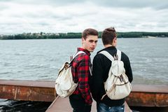 Two young guys stand on the pier Royalty Free Stock Photography
