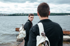 Two young guys standing on a pier stock photography