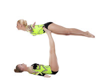 Two young gymnasts in green show exercise isolated Royalty Free Stock Photo