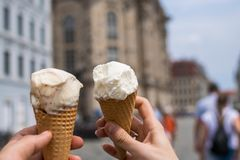 Two young hands holding ice cream royalty free stock photography