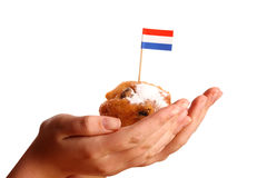 Two young hands offering a typical Dutch donut Royalty Free Stock Photography