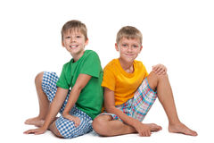Two young handsome boys sit together Royalty Free Stock Photos