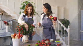 Two young handsome chef florists work at flowers fruit shop making fruit and vegetable bouquet. Two young handsome chef florists work at flowers fruit shop stock video