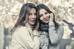 Two young fashion teen girls walking in autumn park Stock Photo