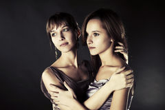 Two young happy fashion women Stock Images