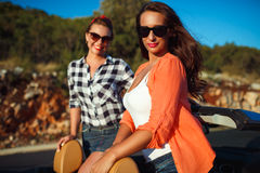 Two young happy girls having fun in the cabriolet outdoors Stock Photography