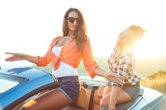 Two young happy girls having fun in the cabriolet outdoors Royalty Free Stock Photography