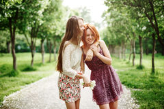 Two Young Happy Girls Having Fun in the Park Stock Photos