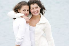 Two young happy girls on nature Royalty Free Stock Photo